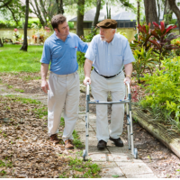 caregiver assisting patient in walking